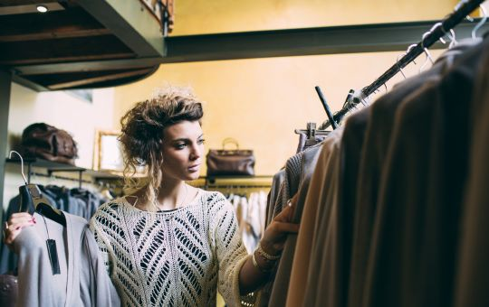 A women shopping in local boutique