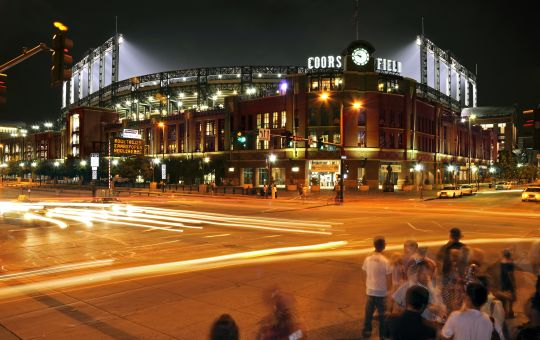 Nighttime view of Coors Field near The Maven Hotel